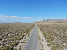 Aerial View Of Asphalt Road In The Middle Of Dusty Dry Desert Land In Lee Vining, Mono County, California, USA