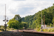 A Norfolk Southern Railroad Crossing In East Pittsburgh, Pennsylvania, USA On A Sunny Summer Day