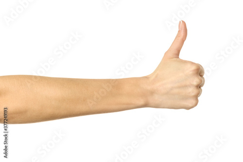 Photo Thumb up. Woman hand gesturing isolated on white