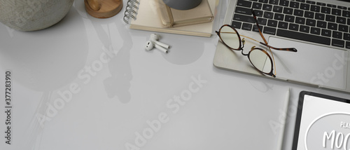 White concept worktable with tablet, laptop, glasses, supplies and copy space Wallpaper Mural