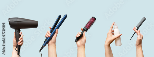 Fotografía Woman hands holding hairdryer, straightener, hairbrush, tail comb and hair care