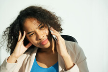 Stressful African Curly Hairstyle Woman Talking On The Phone.