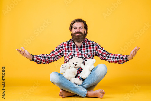 welcome. happy valentines day. cheerful bearded man hold teddy bear. male feel playful with bear. brutal mature hipster man play with toy. happy birthday. being in good mood