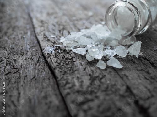 Foto Amphetamine in glass bottle on old wood background