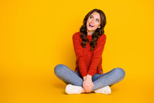 Full Body Photo Of Candid Excited Girl Sit Floor Legs Crossed Look Copyspace Enjoy Rejoice Ads Sales Wear Denim Sweater Isolated Over Shine Color Background