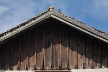 Wood-clad House Gable. The Roof Is Marked By The Forces Of Nature. You Can See The Age In Him.