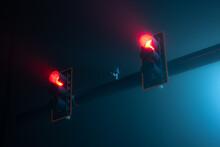 Red Traffic Lights On A Foggy Night