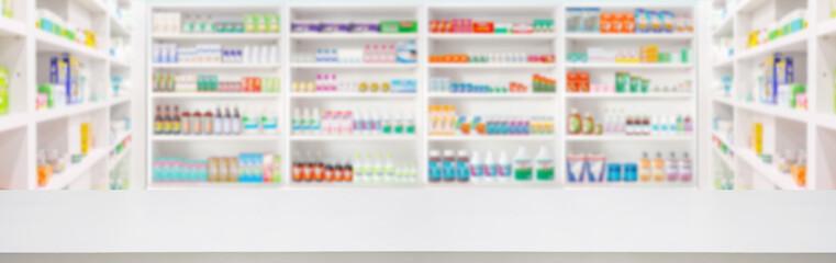 Fototapeta Boks Empty wood counter top with pharmacy drugstore shelves blur pharmaceutical medicine product background
