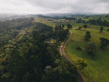 Aerial Shot Driving Through Millaa Millaa Town Sourrandings In Monsoon Season At Tropical Queensland, Australia