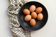 Brown Chicken Eggs In Black Bowl