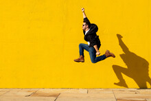 Young Man With Sunglasses Jump...