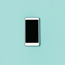 Smartphone With Black Screen On Pastel Green Background. Simple Flat Lay, Top View. Minimal Concept With Copy Space.