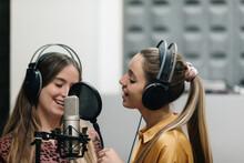 Two Women Singing At Sutdio
