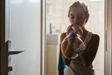 Girl Having Fun Blowing Soap B...