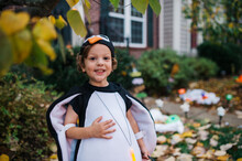 Excited Trick Or Treater Dressed As A Penguin