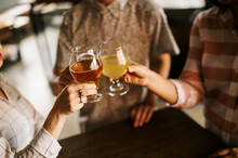 Friends Toasting Craft Beers D...