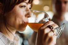 Woman Drinking Craft Beer From A Goblet