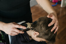 Boy Getting His Hair Clipped At Home