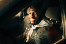 Happy Young African American Man In The Car