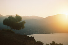 Sun Sets Over A Bay In Cephalonia.