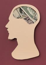 Man Head With A Brain With Dollars Bills