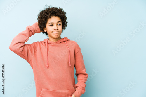 Canvastavla African american little boy isolated touching back of head, thinking and making a choice