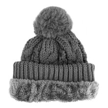 Black Wool Knit Ski Hat With Faux Fur Pompom Isolated On White. Knit Cap Folded Brim. Tuque Or Toque Outdoors Headgear. Knitted Warm Hat. Bobble Hat Topped With Pom Pom Or Loose Tassels