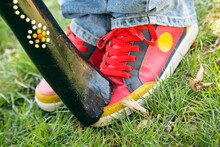 A Didgeridoo Rests On Coloured Sneakers
