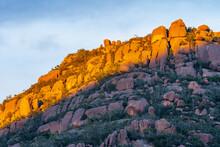 Golden Sunlight Hitting The Tops Of A Rocky Mountain Ridge