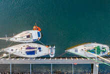 Aerial View Of A Row Boat And Yachts Moored At A Jetty