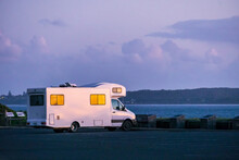 A Campervan Parked At An Ocean Lookout At Twilight