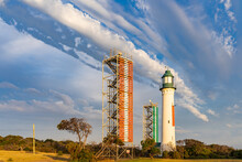 Unusual Cloud Formation Over A Tall Lighthouse
