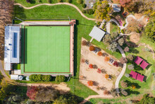 Aerial View Of A Park With Walking Tracks And A Bowling Green