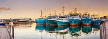 A Fleet Of Fishing Boast Lined...