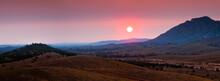 The Sun Rising Through Heavy S...