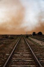 Railway Tracks Leading Into Dust Storm