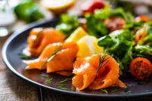 Salmon Salad - Smoked Salmon With Vegetables On Wooden Table