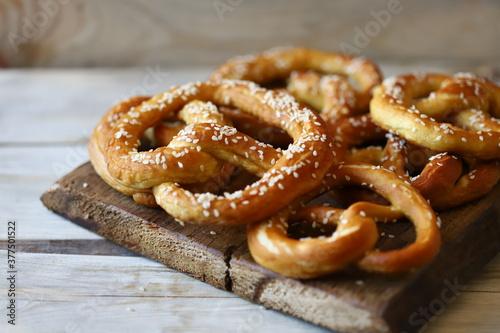 Fresh pretzels on a wooden surface. Preparing for Oktoberfest. Canvas