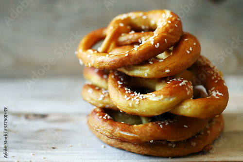 Fresh pretzels on a wooden surface. Preparing for Oktoberfest. Wallpaper Mural
