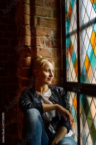 Blond beautiful woman posing near stained-glass window Canvas-taulu