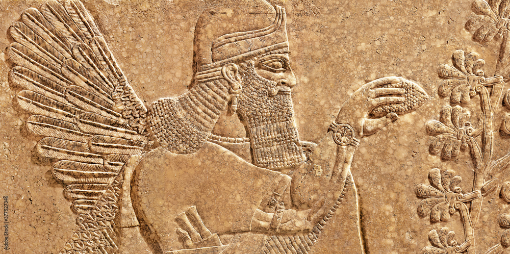 Fototapeta Assyrian wall relief of winged genius