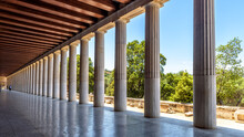 Perspective Of Classical Building Columns In Ancient Agora, Athens, Greece. Panoramic View Inside The Stoa Of Attalos