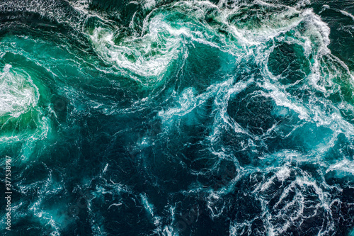 Papel de parede Waves of water of the river and the sea meet each other during high tide and low