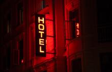 Illuminated Hotel Sign At Night