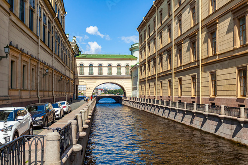 Fototapety, obrazy: St. Petersburg, Russia, July 13, 2020. View of the Zimnyaya Kanavka canal connecting the Moika and Neva rivers, the Hermitage bridge and its picturesque embankments.