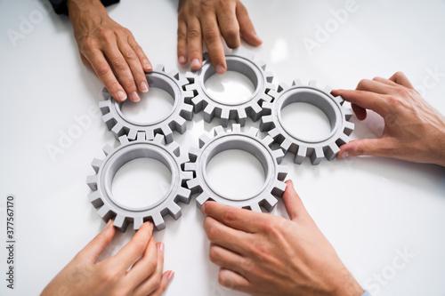 Cuadros en Lienzo Innovative Businesspeople Team Hands Joining Gears