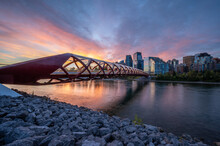 View Of Pedestrian Bridge Over The Bow River In Calgary Alberta At Sunrise.