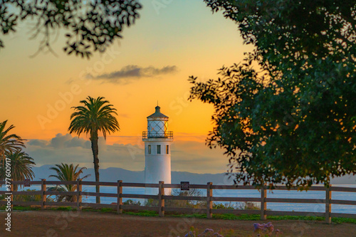 Lighthouse with beautiful trees and sunset Canvas Print