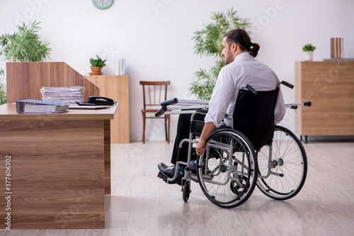 Cuadros en Lienzo Young disabled employee suffering at workplace