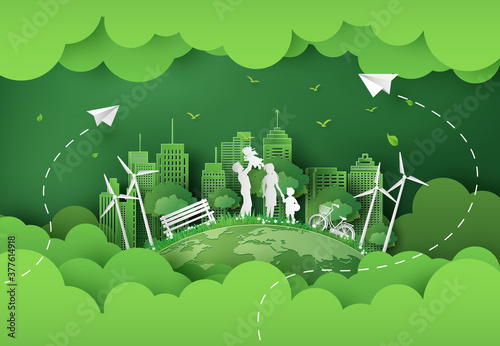 Fototapeta illustration of eco and world environment day with happy family.paper art style. obraz